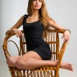 Royalty-Free Stock Photo: Slim girl on a chair