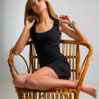 Slim girl on a chair — Stock Photo