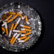Ashtray full of cigarette butts — Stock Photo