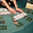 Croupier handling cards at poker table — Foto Stock