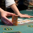 Casino dealer handling big pile — Stockfoto #1135117