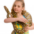 Close-up of sweet girl with pet python - Stock Photo