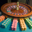 Casino roulette wheel and gambling chips — Stock Photo