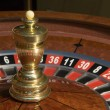 Stock Photo: Roulette wheel spinner close-up