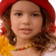 Beauty in the little red hat — Stock Photo #1135362