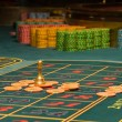 Stock Photo: Roulette gambling chips on the table