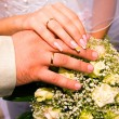 Hands of wife and husband are holding marriage flowers — Stock Photo #1163295