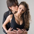 Young passionate hugging couple - Stock Photo