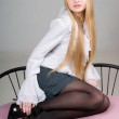 Attractive young blond girl sitting on c — Stock Photo #1163993
