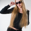 Young blond girl in sunglasses — Stock Photo