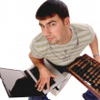 Foto Stock: Contemporary guy with laptop and countin