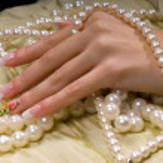 la mano en la perla — Foto de Stock