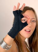 Fine! in black glove — Stock Photo