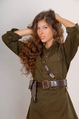Beautiful long-haired girl in military s — Stock Photo