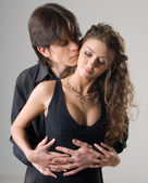 Young passionate hugging couple — Stockfoto