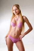 Young blond girl in swimsuit — Stockfoto