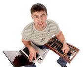 Contemporary guy with laptop and countin — Stock Photo