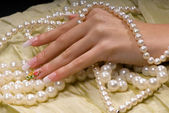 Hand in the pearl — Stock Photo