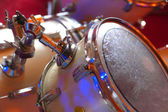 Drum set during performance of music band — Stock Photo
