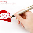Hand draws heart with pen — Stock Photo #1157776