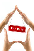 Hands imitating house sale — Stock Photo