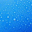 Royalty-Free Stock Photo: Water drops on a blue glass
