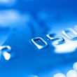 Close-up of a blue credit card. Shallow — Stock Photo