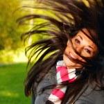 Woman shakes her hairn — Stock Photo
