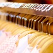 Clothes hanger with shirts — Stock Photo