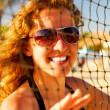 Happy woman behind the volleyball net — Stock Photo #1124613