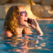 Talking by phone in a pool — Stock Photo #1124640