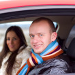 Young couple in a car — Stock fotografie #1125293