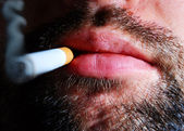 Close-up of an unshaven smoker — Stock Photo