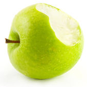 Bitten off green apple — Stock Photo