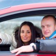 Happy couple in their car — Stock Photo #1156168