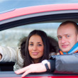 Happy couple in their car — Stock Photo