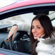 Young woman in a car — Stockfoto