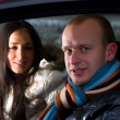 Couple in a car — Stock fotografie