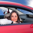 Young woman in a car — Foto de Stock