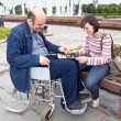 Woman and man on an wheelchair — Stock Photo #1098570