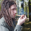 Young man with dreadlock hair. — Stock Photo