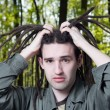 Stock Photo: Young mwith dreadlock hair.