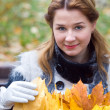 Royalty-Free Stock Photo: The young woman with autumn leaves