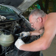 Royalty-Free Stock Photo: The man repairs car