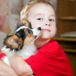 Royalty-Free Stock Photo: Boy and Puppy
