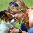 Young woman and her dog — Stock Photo