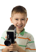 The boy with a retro movie camera — Stock Photo