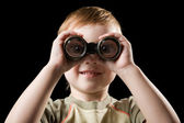 The child watching with binoculars. — Stok fotoğraf