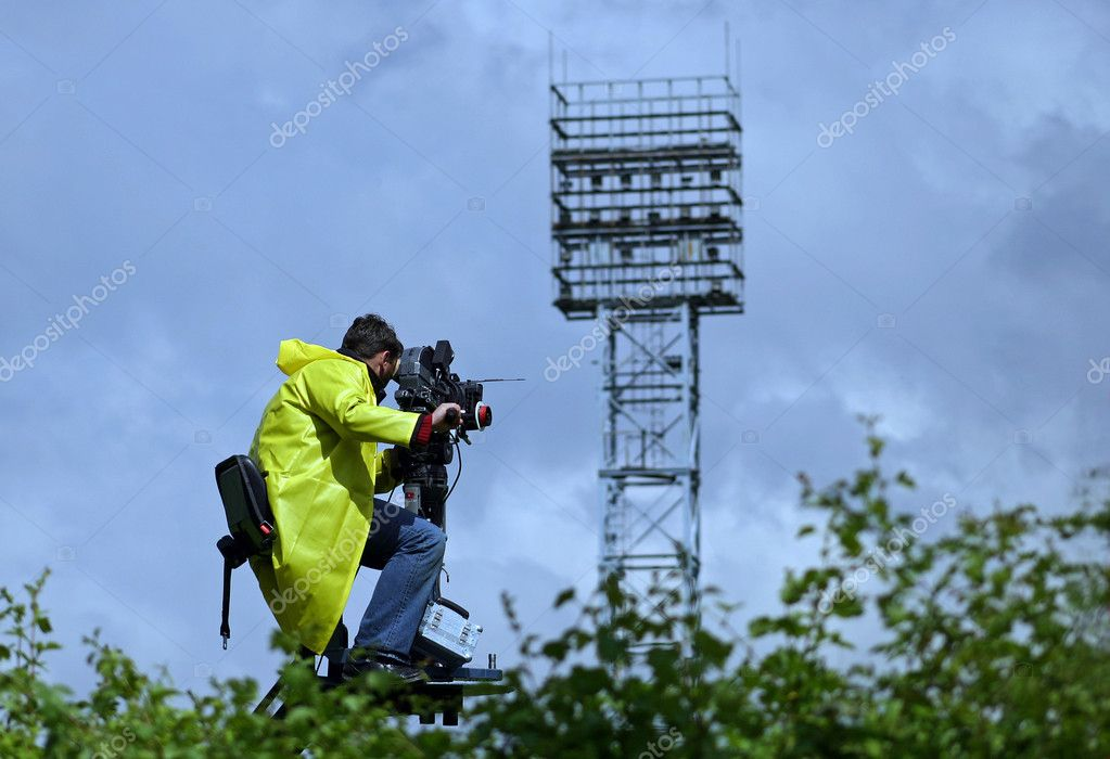 The professional cameraman performing the work — Stock Photo #1114028