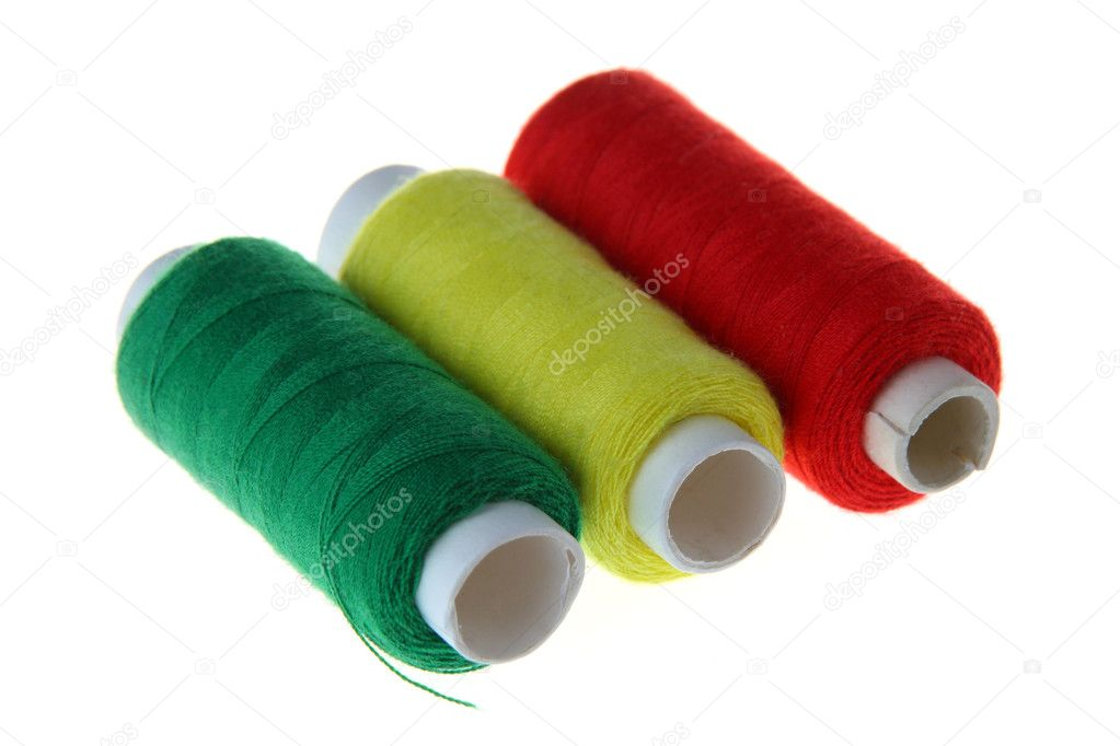 Coils with threads of three colors: red, yellow, green. — Stock Photo #1116788